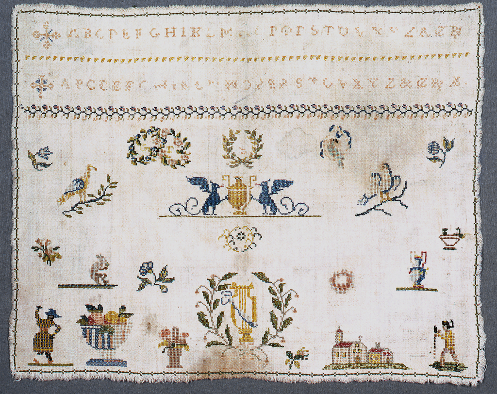 Alphabets, floral cross border, and designs of birds, animals, people, a church and flowers.