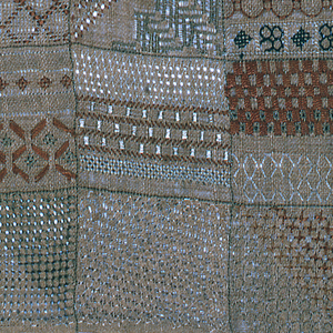Sampler is divided into twenty-one compartments, each showing a number of patterns and several different stitches.