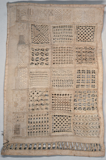 Fifteen squares filled with drawnwork in different patterns; five squares filled with embroidery; one cross of embroidery and one of drawnwork.