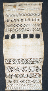 Thirteen cross borders in cut and drawnwork; central portion is not embroidered.