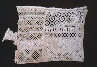 Drawnwork in several different designs arranged in two panels.  Stitches are of the drawnwork type and include woven and wrapped bars and square stitch.