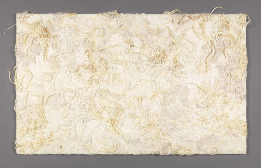 Panel of wool and silk felt in natural unbleached colors, made from the wool of sheep with various fleece characteristics – straight, curly, long, etc.