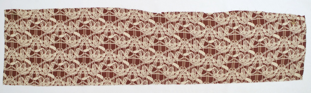 Fragment of printed silk with a wavy linear design of roller coasters, interrupted occasionally by cars of riders, in white on a brown ground.