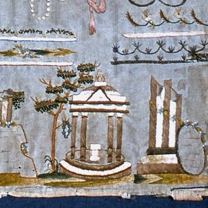 """Flowers, butterfly, basket of flowers, urn, and architectural elements of classical ruins, temples, etc.  Three bows holding grain and a rake, an arrow and a wreath, and cornucopia with flowers.  Sampler reads: """"A growth on time – motion study."""""""