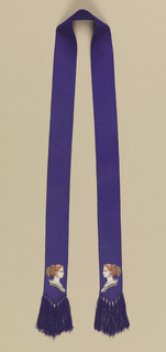 Narrow purple sash with two identical portraits of a woman in profile on each end. Finished with purple fringe.