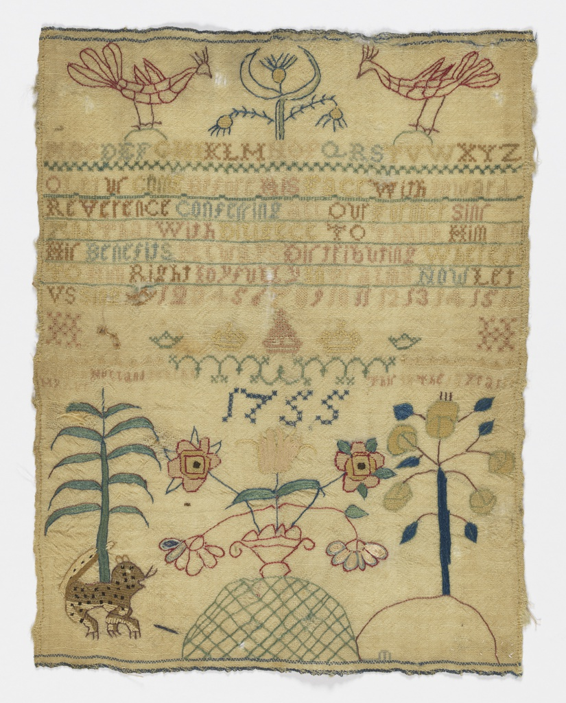 In the center are several bands of neatly worked alphabets, a verse, crowns, the initials HH and the inscription Hannah Holland My Work in the Year 1755. At the top and bottom are very crudely embroidered elements: birds, flowering trees, and a leopard. It seems probable that the top and bottom were not worked by Hannah Holland, the embroiderer of the alphabets.