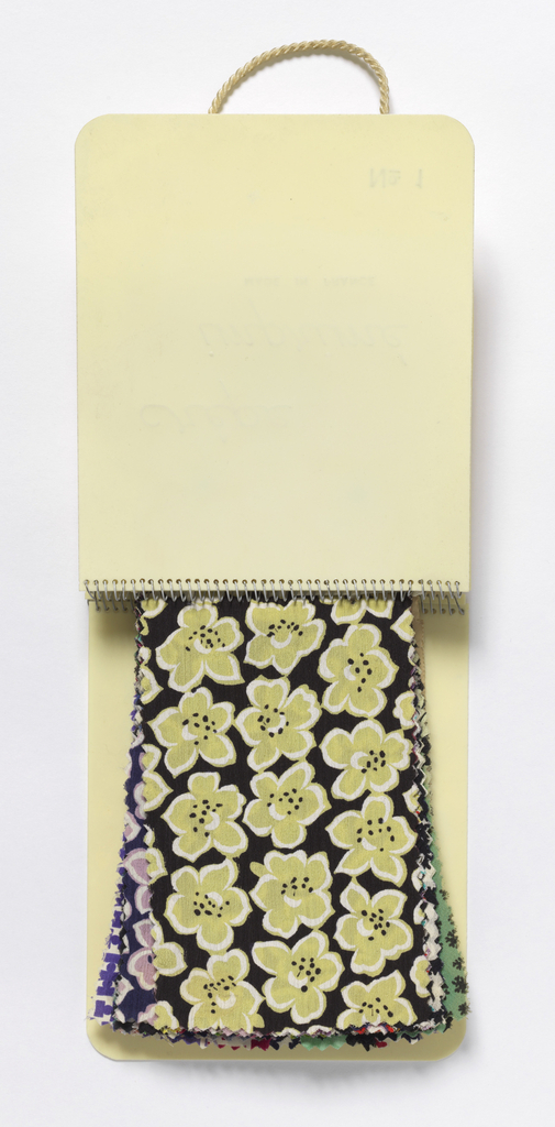 Fifty-nine printed samples in a white celluloid binder printed in gold: Rémond Holland. Lyon. Paris. New York. Crêpe imprimé.