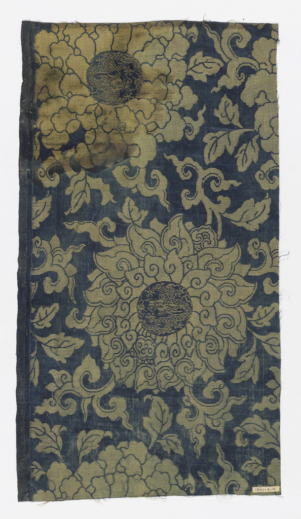 Dark blue ground with large chrysanthemums and vines in olive green.