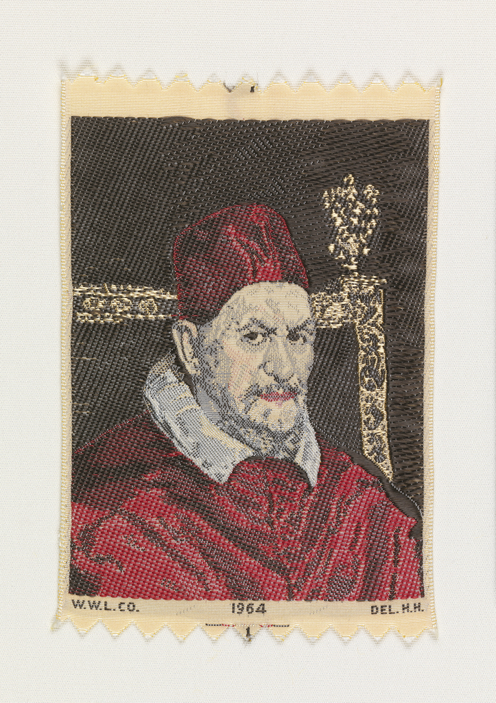 """Woven souvenir based on the painting 'Portrait of Pope Innocent X' (1650) by Diego Velázquez (1599–1660). """"W.W.L. CO. 1964 DEL. H.H."""" appears below the portrait. """"W.W.L. CO."""" represents Warner Woven Label Co.  Del H.H. is the designer's (Howard Huffsschmidt) initials. Red, black, and salmon on white warp."""