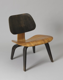 The back and seat are molded to adapt to the human body for comfort. The back are stained in different color, with the seat and a portion of the frame in brown, and the back and the remainder of the frame in black.The back and seat are joined by a frame that is also molded plywood. The placement of rubber mounts between the frame and the back and seat ensures added comfort.