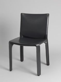 Side chair with metal frame of basic profile entirely covered in leather.