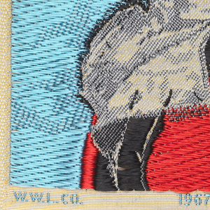 """Woven souvenir based on the painting 'Mrs. Frances Tucker Montresor' (ca. 1778) by John Singleton Copley (1738-1815). """"W.W.L. CO. 1967 DEL. H.H."""" appears below the portrait. Blue, red, golden-yellow, gray, and black on white warp."""