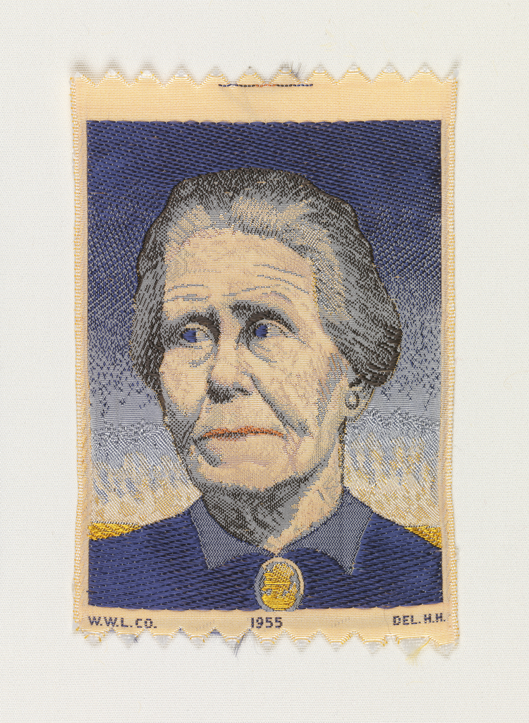 """Woven souvenir based on the painting 'Woman with Plants' (1929) by Grant Wood (1891–1942).  """"W. W. L. Co. 1955 DEL. H. H."""" woven in lower part. Gold-yellow, brown, blue, gray, and salmon on white warp."""