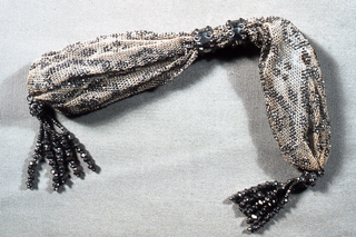 Miser's purse with beaded ornament and tassels of steel beads.