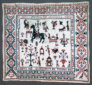 """Small sampler with central square filled with embroidered objects i.e. rider on horseback, man walking a dog, floral forms with birds, man picking fruit, two men fishing, a fountain, small building, and a heart surrounded by a band of writing: """"LO. HIZO. CATALINA. DE. ARANAGA. SIENDO DICIPOLA. DE. LA. SA MAESTRA DA MARIA. DE ACHOTEQUI. EN LA EDA DE 10  ANOS ANO DE 1832.""""  Translation: """"Made by Catalina de Aranaga under the instruction of her teacher Senora Maria de Achotequi. Aged 10 years. In the Year of 1832.""""  Surrounded by wide borders - two of which are the same but the colors are reversed.  All embroidered in red and blue on white background.  Except for very narrow borders and some writing, all executed in cross stitch."""