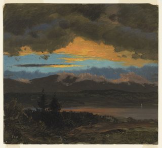 A view over wooded hills in foreground, through a middle distance showing a lake beneath a strip of blue sky with golden-yellow illuminated clouds reflecting the last of the setting sun, and looking toward distant dark mountains capped by heavy dark brownish-gray clouds beyond.