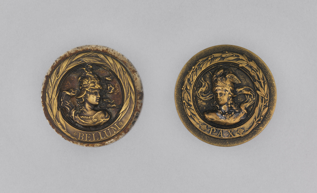 """Circular button with bust of woman (?) in helmet and armor; """"PAX"""" under figure, within band around rim.  On card 43"""
