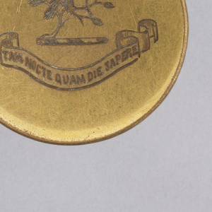 3 circular buttons with engraved crest and motto of the Hewitt family.