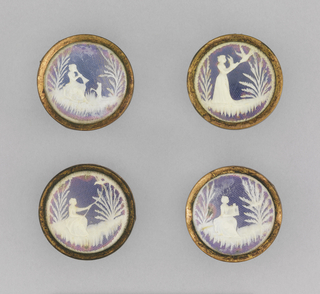 Four buttons depicting a young woman catching a bird, from bird call to bird cage, all in carved ivory over a colored foil ground.