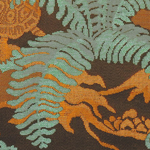 Dark brown satin ground with design of turtles, snails, rocks and ferns, in green, light brown and gold silks.