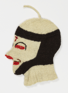 Knitted mask to completely cover the head in black and white wool with eyes, lips and nostrils outlined in red wool; a red cross in center of forehead. Used for the celebration of Quyllur Rit'i or Star Snow Festival: a spiritual and religious festival held annually at the Sinakara Valley in the Cusco Region of Peru in late May or early June.