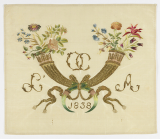 "Two crossed horns with flowers springing from the top. Horns in gold with tips in silk. Flowers in silk. Between horns at top are initials in gold: ""OC"". At left: ""L"" and at right: ""A"". Between tips of horns: ""1838""."