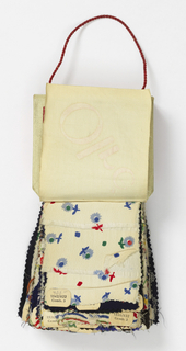 """One hundred twenty-three samples of silk and synthetic fiber fabrics. Six are double cloths with woven designs; one hundred and seventeen are printed plain weaves, plain twills, crepes, double cloths and novelty weaves. Bound at the top with white pique covered cardboard, printed in red: """"Tissus Haute Couture, Inc. Olré."""""""