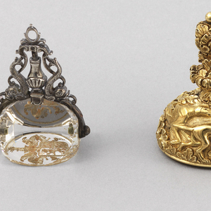"""The handle with hole for chain, the mount decorated with dogs and quail in foliage, the citrine seal armorials below the crest in supporters """"Festina Lente"""" above """"Pour Nous"""" below."""