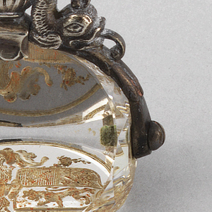 Revolving seal of rock crystal carved with a coat-of-arms. The silver handle is composed of dolphins.