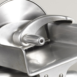 Steel streamlined meat slicer with rounded knobs.
