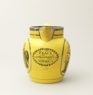 """Tapering bulbous form with circular mouth and deep spout; large, squared loop handle. Yellow glaze ground with silver luster bands and black transfer-printed decoration:  on one side, medalion with message, """"May The Tree of Liberty Ever Flourish,"""" accompanied by various symbols and attributes; on the opposite side, cartouche with message """"Success to the United States of America,"""" accompanied by symbols and attributes, and surmounting ribbon with """"E Pluribus Unum""""; under spout, """"Peace and Prosperity to America"""" within oval wreath. Yellow-glazed interior."""