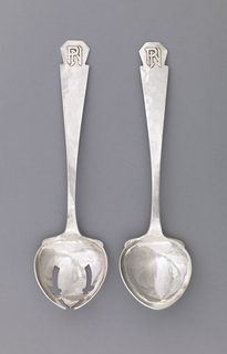 "Pair of salad servers. Fork (-1) has leaf-shaped bowl and monogram applied on pentagonal terminal: ""PN""; like spoon (-2) but slotted and open."