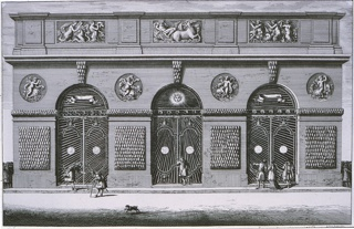 Horizontal rectangle:  Building with three arched openings enclosed by grills.  Above, three rectangular bas reliefs and four bas relief medallions, all on sea themes.