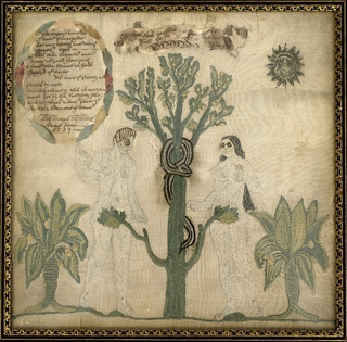 Adam and Eve, with a biblical verse written on paper and stitched to the ground.