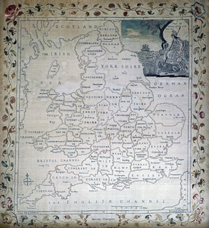 A map of England and Wales embroidered in pale colored silks on a silk ground.
