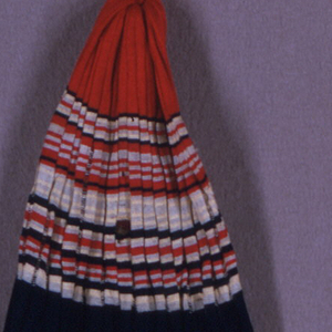Neapolitan fisherman's cap of knitted silk. Roman-striped in red, cream and blue.