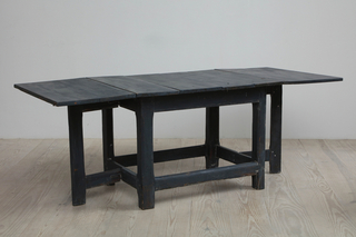 Drop leaf table with iron hinges