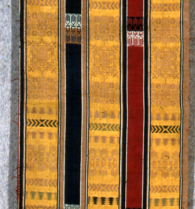 Stripes in gold, blue and red with geometric designs and decorative script.