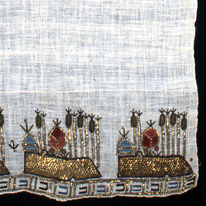 Towel of white hand-woven cotton with ends embroidered in detached designs, simulating an island with tall trees and other forms. Pattern embroidered in red, rose, green, light blue and gold. Simple border of block design in gold and colors.