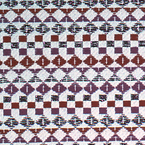 White warp and weft with supplementary weft in orange, pink and pink metallic, forming diamonds, squares and triangles. Serged on two sides and cut on two sides.