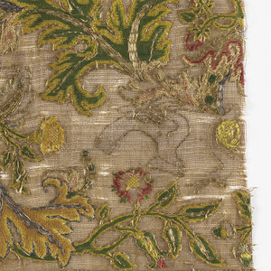 Gauze weave (buratto) with embroidery of scrolling steam with flowers, leaves and birds arranged as corner ornament and wide border between narrow borders of repeating conventionalized forms.