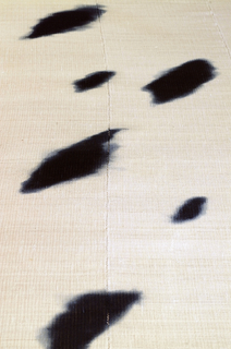 Irregular pattern of dark blue cloud-like shapes on three off-white panels that are stitched together.