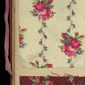 Red cloth bound portfolio containing 154 miscellaneous samples of printed cottons.