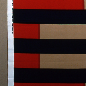 Horizontal bands of equal width in red, blue and tan.  The blue bands are continuous and alternate with bands made up of red and tan.