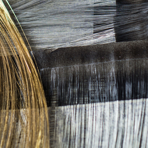 Short lengths of gilded paper, slit for use as wefts in weaving obi.