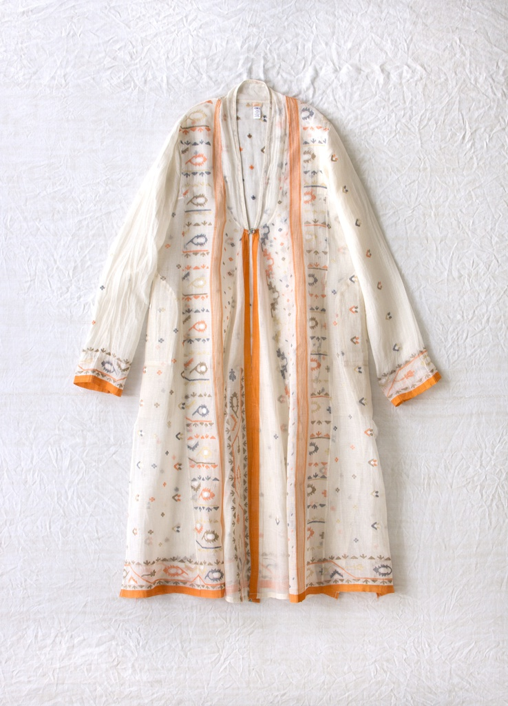 Flowing, long-sleeved coat with a v-shaped neckline, tie closure. White with borders of orange and green brocaded floral pattern.