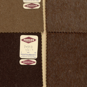 Sample book of woolen suiting fabric from various manufacturers in plain colors, plaids and various weaves.