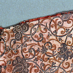 Satin damask silk weave in pink and silver with delicate scrolls and silver brocaded palmettes.