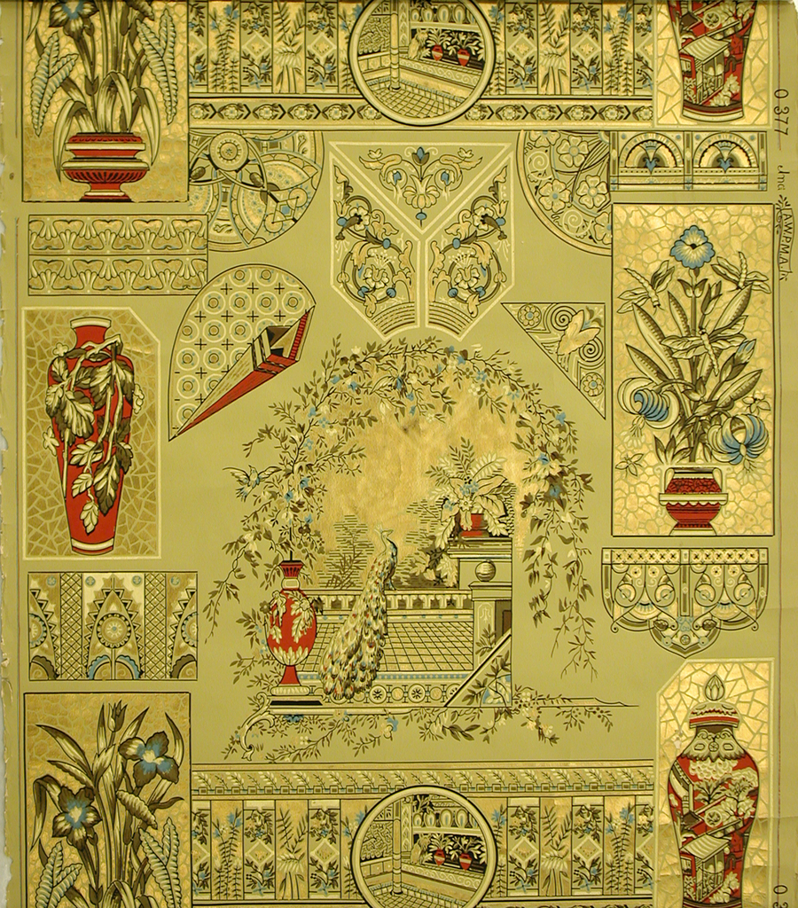 Asymmetrical arrangement of motifs, with central landscape view of a peacock perched on a balustrade under an arbor. This view is surrounded by other motifs include ceramic vases, potted plants and rondelle with interior view. Printed in metallic gold, red, black, brown and blue on an ocher ground.