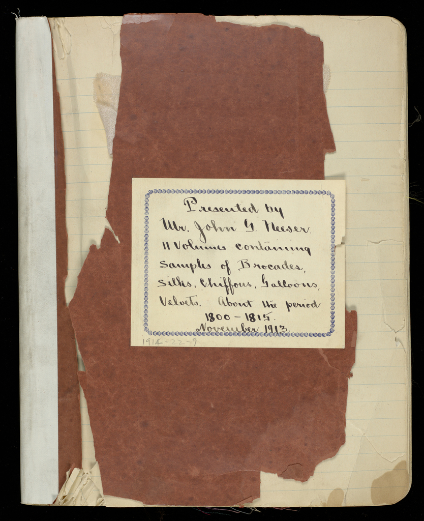 Lined notebook with red covers containing 284 textile samples with French titles pasted over many of them. One missing.